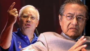 Current Prime Minister Najib Razak (left side) and former Prime Minister Dr. Tun Mahathir (right side).